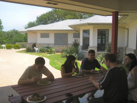 A photo given to me by Gary showing Alpha Leaders eating next to the BBQ. You can see some of the backyard of Stephen and Alicia's place. Their swimming pool is to the left of the photo.