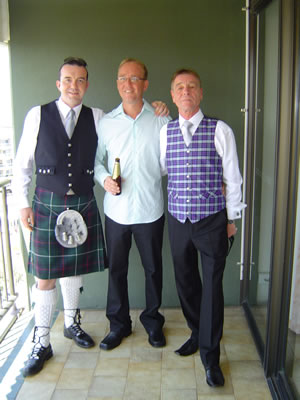 Colin in a kilt next to the groom, John and his dad John