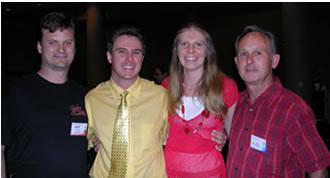 Photo of Vanya and Jody alongside of dad and me